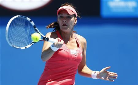 Agnieszka Radwanska of Poland hits a return to Bojana Bobusic of Australia during their women's singles match at the Australian Open tennis tournament in Melbourne, January 14, 2013. REUTERS/Daniel Munoz