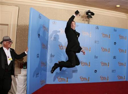 Director Mark Andrews, winner for Best Animated Feature Film for ''Brave,'' celebrates backstage with his award at the 70th annual Golden Globe Awards in Beverly Hills, California, January 13, 2013. REUTERS/Lucy Nicholson