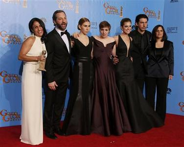 The cast and crew of ''Girls,'' (From L:) producer Jennifer Konne, producer Judd Apatow, cast members Zosia Mamet. Lena Dunham, Allison Williams and Adam Driver and director Ilene S. Landress, pose backstage after they won for Best Televison Series, Comedy or Musical at the 70th annual Golden Globe Awards in Beverly Hills, California, January 13, 2013. REUTERS/Lucy Nicholson