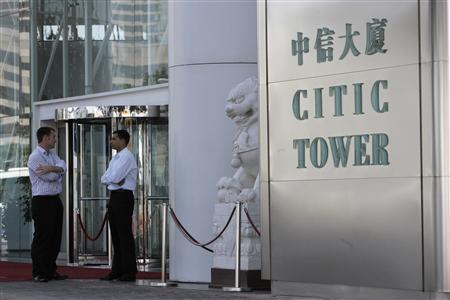 Executives chat outside the CITIC Pacific office building in Hong Kong in this October 21, 2008 file photograph. REUTERS/Woody Wu/Files