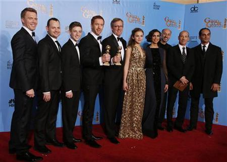 The cast and producers of the tv drama series ''Homeland,'' from left, actor Diego Klattenhoff, executive producer Gideon Raff, actor Timothie Chalamet, actor Damian Lewis, executive producer Alex Gansa actress Morgan Saylor, actress Morena Baccarin, actor David Marciano, executive producer Howard Gordon and actor Navid Negahban, pose together backstage after ''Homeland'' won the award for Best Drama Series at the 70th annual Golden Globe Awards in Beverly Hills, California, January 13, 2013. REUTERS/Lucy Nicholson