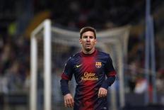Lionel Messi, quadruple Ballon d'Or, auteur d'un but contre Malaga dimanche. Le Barça a terminé dimanche la première moitié de la saison du championnat espagnol en prenant 55 points sur 57 possibles, un record en Liga, après une victoire 3-1 sur la pelouse de ses adversaires. /Photo prise le 13 janvier 2013/REUTERS/Jon Nazca