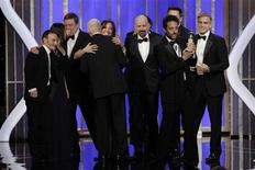 """Argo"" Producer Grant Heslov, with trophy, and cast and crew accept the award for Best Motion Picture, Drama, for ""Argo"" at the Golden Globe Awards in Beverly Hills, California January 13, 2013, in this picture provided by NBC. REUTERS/Paul Drinkwater/NBC/Handout"