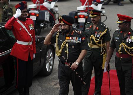 India's army chief General Bikram Singh (C) arrives at the Indian Peacekeeping Force Memorial for a commemoration ceremony in Colombo December 20, 2012. REUTERS/Dinuka Liyanawatte