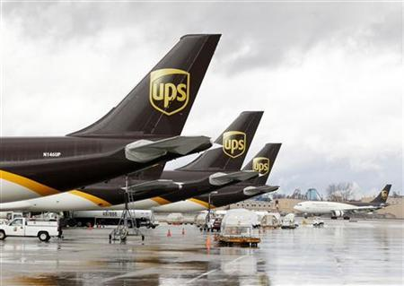 United Parcel Service aircrafts are being loaded with air containers full of packages bound for their final destination at the UPS Worldport All Points International Hub during the peak delivery day in Louisville, Kentucky, December 20, 2012. REUTERS/John Sommers II (UNITED STATES - Tags: BUSINESS TRANSPORT)