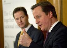 Britain's Prime Minister, David Cameron (R), accompanied by Deputy Prime Minister, Nick Clegg, speaks at a news conference in 10 Downing Street in central London January 7, 2013. REUTERS/Peter Nicholls/Pool