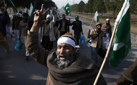 A supporter of Muhammad Tahirul Qadri, leader of Mihaj-ul-Quran, shouts slogans as he marches toward Islamabad to take part in a protest January 14, 2013. REUTERS/Zohra Bensemra