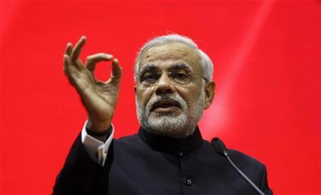 Gujarat's chief minister Narendra Modi speaks during the ''Vibrant Gujarat Summit'' at Gandhinagar in the western Indian state of Gujarat January 12, 2013. REUTERS/Amit Dave/Files