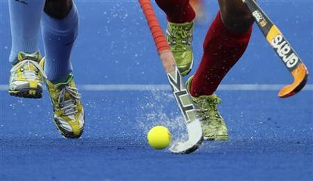 Players challenge for the ball during a men's Group B hockey match at the Riverbank Arena at the London 2012 Olympic Games August 5, 2012. REUTERS/Sergio Moraes/Files