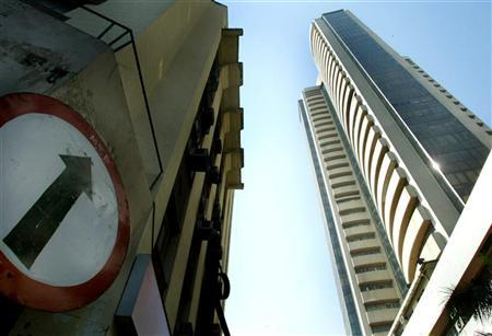 A traffic-sign near the stock exchange building (right) reflects the sharp increase in the stock index in Mumbai January 2, 2004. REUTERS/Punit Paranjpe/Files