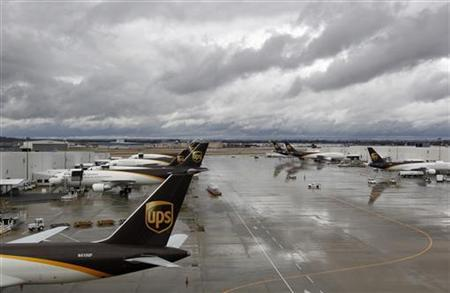 United Parcel Service aircrafts are being loaded with air containers full of packages bound for their final destination at the UPS Worldport All Points International Hub during the peak delivery day in Louisville, Kentucky, December 20, 2012. REUTERS/John Sommers II