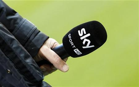 A microphone of Sky Sport TV station is seen before the German Bundesliga first division soccer match between Bayern Munich and Hoffenheim in Munich March 10, 2012. REUTERS/Michaela Rehle (GERMANY - Tags: MEDIA SPORT SOCCER)