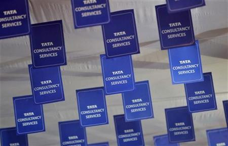 Logos of Tata Consultancy Services (TCS) are displayed at the venue of the annual general meeting of the software services provider in Mumbai, June 29, 2012. REUTERS/Vivek Prakash