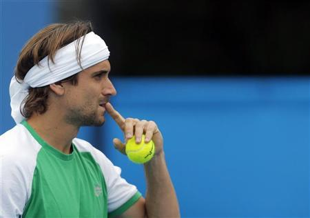 David Ferrer of Spain arrives for a practice session at the Australian Open tennis tournament in Melbourne January 13, 2013. REUTERS/Damir Sagolj