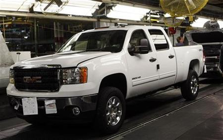 A 2011 GMC Sierra pickup truck moves down the final production line at the Flint Assembly in Flint, Michigan January 24, 2011. REUTERS/Rebecca Cook