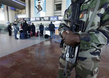 A french soldier patrols at Nice Cote d'azur International airport January 14, 2013. REUTERS/Eric Gaillard