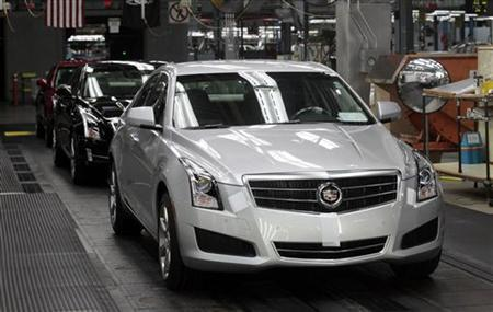 A 2013 ATS Cadillac luxury vehicle waits to roll of the final line at the Lansing Grand River Assembly Plant in Lansing, Michigan July 26, 2012. REUTERS/Rebecca Cook