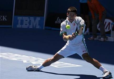 Novak Djokovic of Serbia hits a return to Paul-Henri Mathieu of France during their men's singles match at the Australian Open tennis tournament in Melbourne, January 14, 2013. REUTERS/David Gray