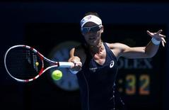 Samantha Stosur of Australia hits a return to Chang Kai-Chen of Taiwan during their women's singles match at the Australian Open tennis tournament in Melbourne, January 14, 2013. REUTERS/David Gray