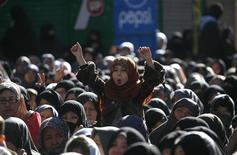 A girl from the Shi'ite Hazara community gestures as she attends a funeral ceremony of the victims who were killed three days ago by a bomb blast in Quetta January 14, 2013. Shi'ite Muslims agreed on Monday to begin burying nearly 100 of their people killed in one of Pakistan's deadliest sectarian attacks after Pakistan's Prime Minister Raja Pervez Ashraf said he would comply with their demands to sack the local government. REUTERS/Naseer Ahmed