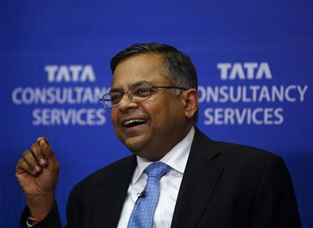 N. Chandrasekaran, chief executive of Tata Consultancy Services Ltd (TCS), laughs while interacting with the media during a news conference in Mumbai January 14, 2013. REUTERS/Danish Siddiqui