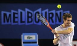 Andy Murray of Britain hits a return during a practice session at the Australian Open tennis tournament in Melbourne January 13, 2013. REUTERS/Toby Melville