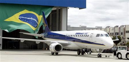 File photo of Brazilian aircraft manufacturer Embraer unveiling the EMBRAER 190 regional jet, February 9, 2004. REUTERS/Paulo Whitaker