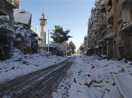 Snow covers buildings damaged by what activists said were missiles fired by a Syrian Air Force fighter jet loyal to President Bashar al-Assad, in Daraya, near Damascus, January 10, 2013. Picture taken January 10, 2013. REUTERS/Kenan Al-Derani/Shaam News Network/Handout