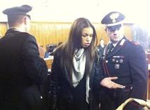 "Karima El Mahroug, better known by her stage name ""Ruby the heartstealer"", gestures at Milan's court January 14, 2013. The young nightclub dancer at the centre of Silvio Berlusconi's sex trial arrived in court to testify on Monday but the former Italian premier's lawyer asked for the case to be suspended until after elections next month. REUTERS/Alessandro Garofalo"
