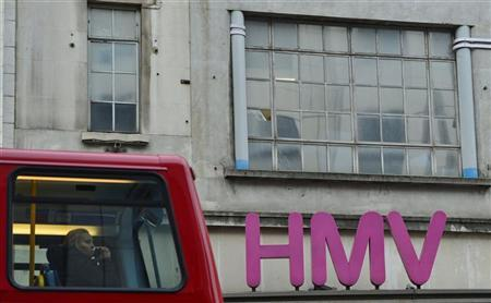 A bus passes an HMV store in central London December 13, 2012. REUTERS/Toby Melville