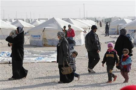 Syrian refugees walk near newly pitched tents at the Al-Zaatari refugee camp in the Jordanian city of Mafraq, near the border with Syria, January 1, 2013. REUTERS/Ali Jarekji (JORDAN - Tags: POLITICS CIVIL UNREST SOCIETY IMMIGRATION)