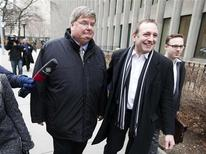 Former Nortel Chief Financial Officer Douglas Beatty leaves the courthouse with his lawyer Gregory Lafontaine (R) in Toronto, January 14, 2013. An Ontario Superior Court on Monday dismissed fraud charges against three former top executives at bankrupt Nortel Networks after a year-long trial involving one of the most spectacular casualties of the 1990's dot-com bubble. Former Chief Executive Frank Dunn, former CFO Beatty and former Controller Michael Gollogly were found not guilty of misrepresenting Nortel's financial results between 2000 and 2004 in a plan that prosecutors alleged brought them bonus payments while defrauding investors. REUTERS/Mark Blinch