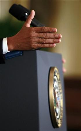 U.S. President Barack Obama gestures during a news conference in the East Room of the White House in Washington, January 14, 2013. REUTERS/Jason Reed (UNITED STATES - Tags: POLITICS)