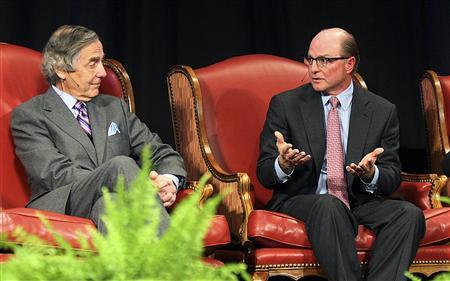 SandRidge Energy CEO Tom Ward (R) speaks with chairman and majority shareholder of BOK Financial George Kaiser during an energy panel discussion at the Creativity Oklahoma World Forum in Oklahoma City, in this November 15, 2011 file photo courtesy of the Journal Record. REUTERS/Maike Sabolich/The Journal Record