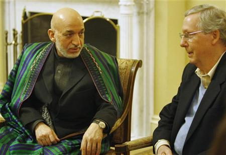Afghan President Hamid Karzai (L) meets with Senate Minority Leader Mitch McConnell (R-KY) (R) at the U.S. Capitol in Washington January 9, 2013. REUTERS/Jonathan Ernst