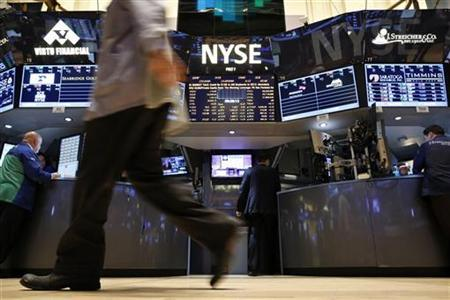 Traders work on the floor of the New York Stock Exchange, December 18, 2012. REUTERS/Brendan McDermid/Files