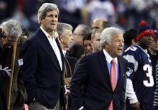 U.S Senator and Nominee for U.S. Secretary of State John Kerry (L) (D-Massachusetts) stands on the sidelines with New England Patriots owner Robert Kraft before the NFL AFC Divisional playoff football game between the Patriots and the Houston Texans in Foxborough, Massachusets January 13, 2013. REUTERS/Jessica Rinaldi