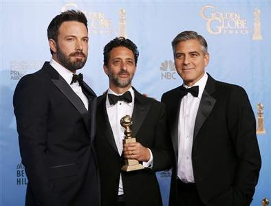 Producer and director Ben Affleck (L) poses with ''Argo'' producers Grant Heslov (C) and George Clooney after Affleck won Best Director and ''Argo'' won the award for Best Motion Picture Drama at the 70th annual Golden Globe Awards in Beverly Hills, California January 13, 2013. REUTERS/Lucy Nicholson