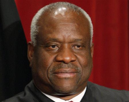 U.S. Supreme Court Justice Clarence Thomas poses for an official photograph with the other Justices at the Supreme Court in Washington, in this September 29, 2009 file photo. REUTERS/Jim Young/Files
