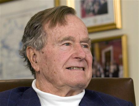 Former U.S. President George H.W. Bush listens to Republican presidential candidate Mitt Romney in Houston, Texas, in this March 29, 2012 file photo. REUTERS/Donna Carson/Files