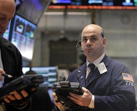 Traders work on the floor of the New York Stock Exchange, January 14, 2013. REUTERS/Brendan McDermid