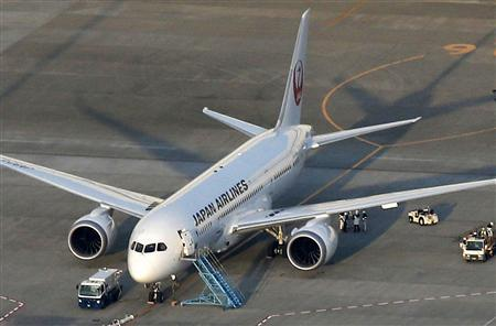 Japan Airlines' (JAL) Boeing 787 plane which leaked fuel during tests, is pictured at New Tokyo international airport in Narita, east of Tokyo, in this photo taken by Kyodo on January 13, 2013.REUTERS/Kyodo