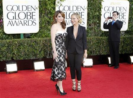 Golden Globe co-hosts, actresses Tina Fey (L) and Amy Poehler, arrive at the 70th annual Golden Globe Awards in Beverly Hills, California, January 13, 2013. REUTERS/Mario Anzuoni