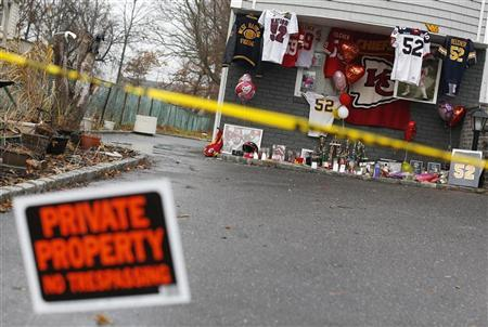 A makeshift memorial for Kansas City Chiefs football player Jovan Belcher is seen outside his mother's home in West Babylon, New York December 4, 2012. Belcher, 25, shot and killed his 22-year-old girlfriend Kasandra Perkins, the mother of his three-month-old daughter, in front of his own mother at home before driving to Arrowhead Stadium where he shot himself dead in the parking lot after thanking team officials for all they had done for him. REUTERS/Shannon Stapleton