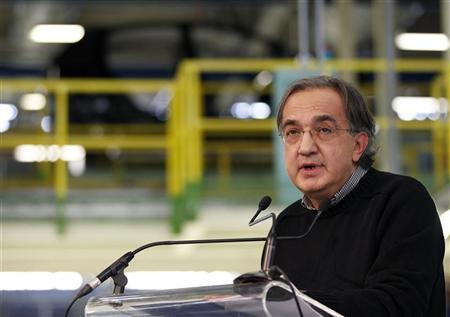 Fiat-Chrysler chief executive Sergio Marchionne makes his speech during the visit of Italy's Prime Minister Mario Monti at the Fiat car factory in the southern city of Melfi December 20, 2012.REUTERS/Ciro De Luca