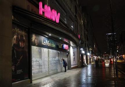 A man peers into a branch of British retail music chain HMV on Oxford Street in London January 14, 2013. Music and DVD retailer HMV may announce as soon as Monday that it will call in the administrators, according to a source close to the company and media reports, bringing the curtain down on one of Britain's best-known high street stores. REUTERS/Chris Helgren