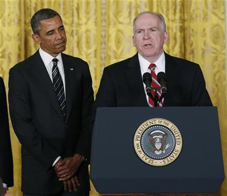 U.S. President Barack Obama (L) stands next to John Brennan, (R), during the announcement for his nominations for a new secretary of defense and new CIA director at the White House in Washington January 7, 2013. REUTERS/Kevin Lamarque (UNITED STATES - Tags: POLITICS)