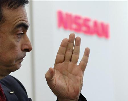 Nissan Chief Executive Officer Carlos Ghosn speaks at a round table meeting with reporters at its headquarters in Yokohama, south of Tokyo, December 18, 2012. REUTERS/Kim Kyung-Hoon