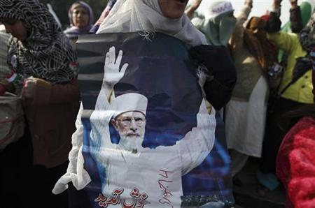 A woman holds a photograph of Muhammad Tahirul Qadri, leader of Mihaj-ul-Quran, during a protest in Islamabad January 14, 2013. REUTERS/Zohra Bensemra