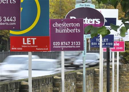 Cars pass property sales and letting signs in west London October 28, 2010. REUTERS/Toby Melville